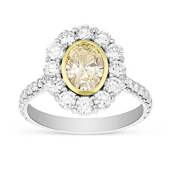 Platinum Fancy Light Yellow Oval Diamond Ring with Diamond Halo and Shank