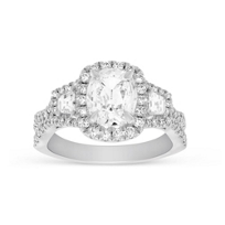 Henri_Daussi_18K_White_Gold_Cushion_Diamond_With_Trapezoid_Diamonds_and_Round_Diamond_Halo_Ring