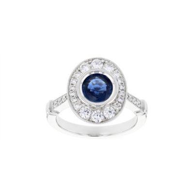 18k white gold round sapphire & diamond oval milgrain halo ring