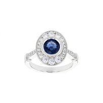 18k_white_gold_round_sapphire_&_diamond_oval_milgrain_halo_ring_