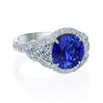 J.B._Star_Platinum_Sapphire_and_Diamond_Halo_Ring